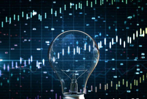 Lightbuld in front of trading board