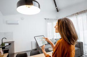Woman measuring electricity use on ipad
